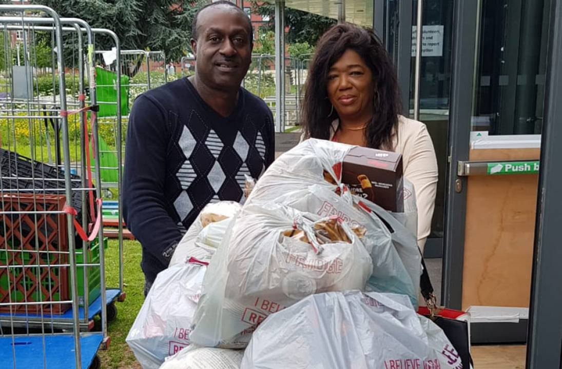 Dr Marcia McLaughlin helps Prison Link to Distribute food bags to their clients