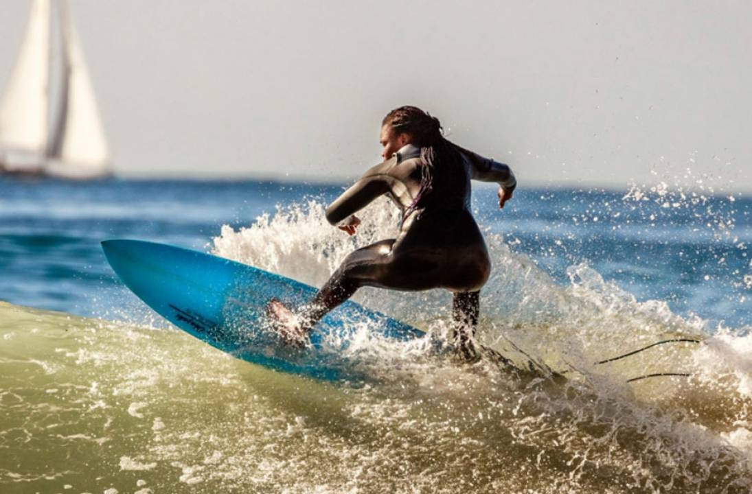 Khadjou representing Senegal as their first female professional surfer ever